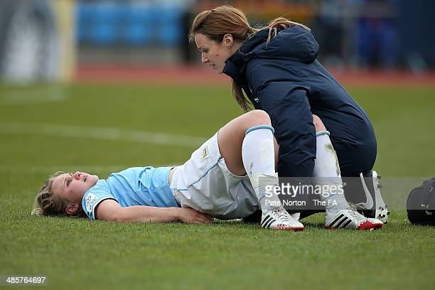 Isobel Christiansen of Manchester City Women recieves treatment during the FA WSL 1 match between Manchester City Women and Bristol Academy Women at...