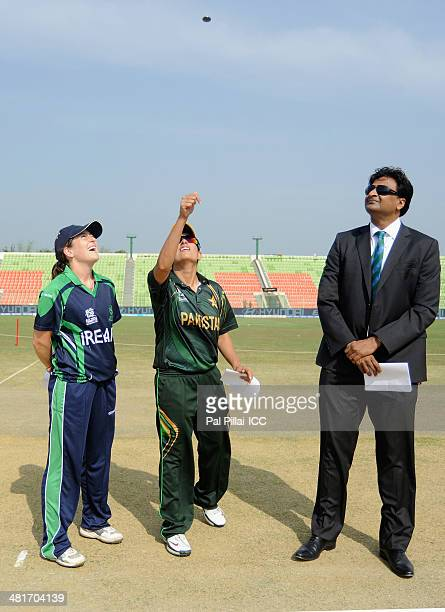 Isobel Joyce captain of Ireland Sana Mir captain of Pakistan and ICC match referee Javagal Srinath during the toss before the start of the ICC...