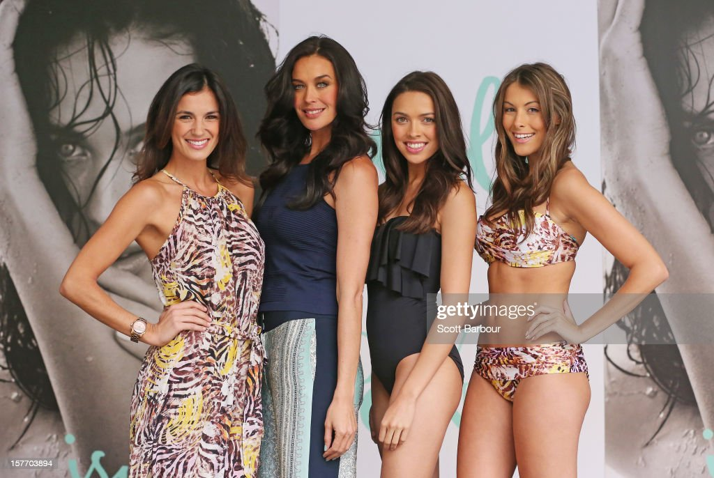 Isola designer <a gi-track='captionPersonalityLinkClicked' href=/galleries/search?phrase=Megan+Gale&family=editorial&specificpeople=202042 ng-click='$event.stopPropagation()'>Megan Gale</a> (2nd L) poses with models during an Isola Swimwear range preview event at David Jones Bourke Street on December 6, 2012 in Melbourne, Australia.