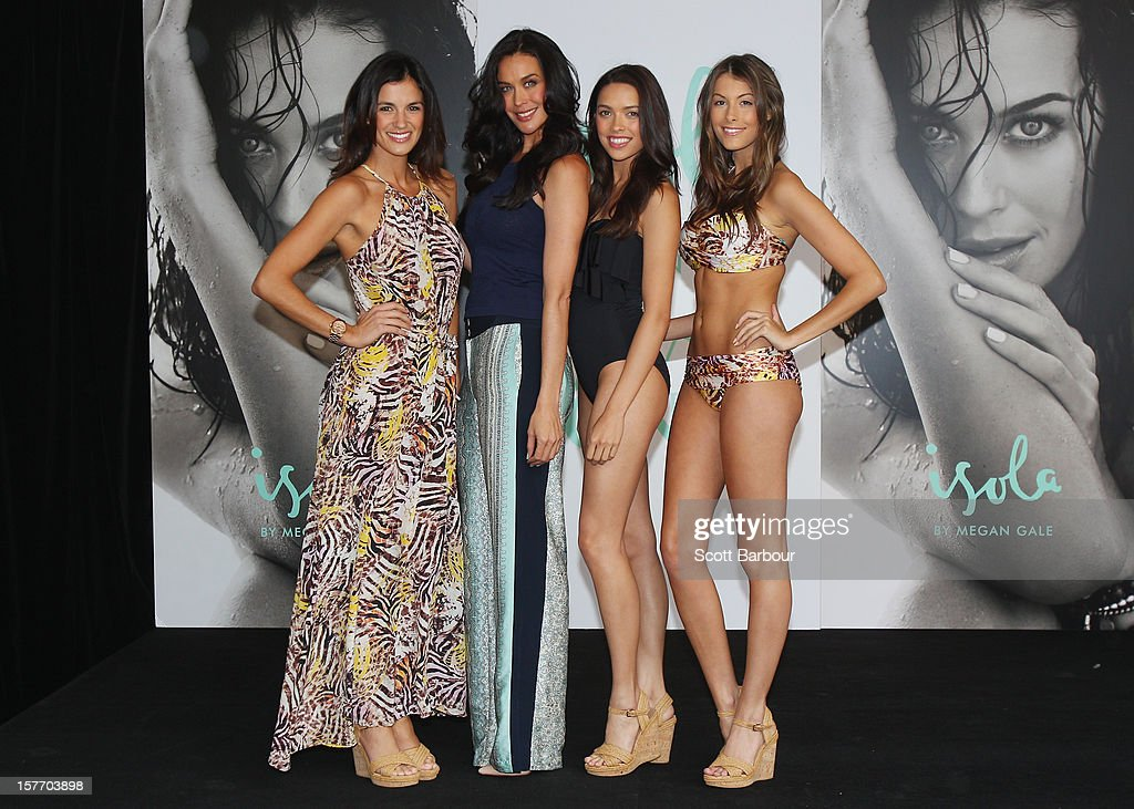 Isola designer Megan Gale (2nd L) poses with models during an Isola Swimwear range preview event at David Jones Bourke Street on December 6, 2012 in Melbourne, Australia.