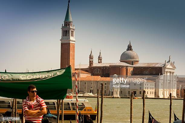 Isola San Giorgio Maggiore with church from the city of Venice with Gran Canal and gondolier Italy Europe