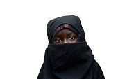 Little African girl posing outdoors veiled by a Niqab (typical traditional muslim clothing).