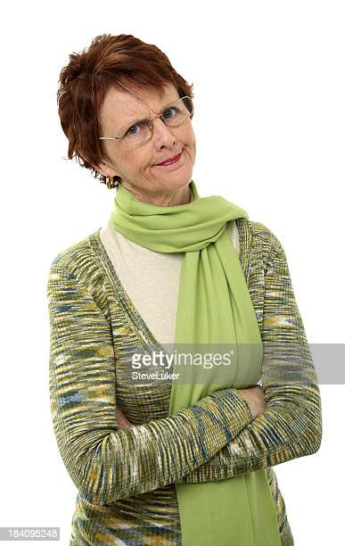 Isolated angry lady with crossed hands wearing green clothes
