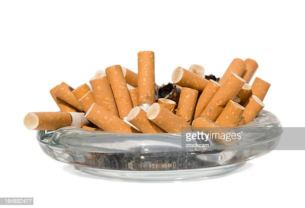 Isolated ashtray with cigarette butts