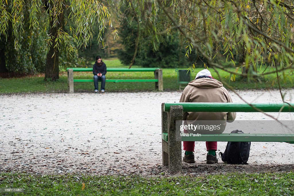 Isolated bench sitters : Stock Photo