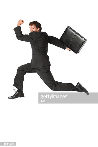 Isolated businessman leaping through the air running