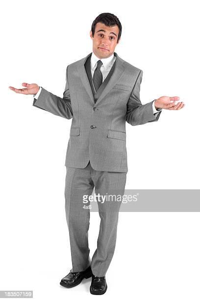 Isolated businessman shrugging
