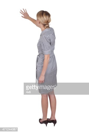 Isolated businesswoman presenting back view