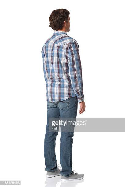 Isolated casual man rear view