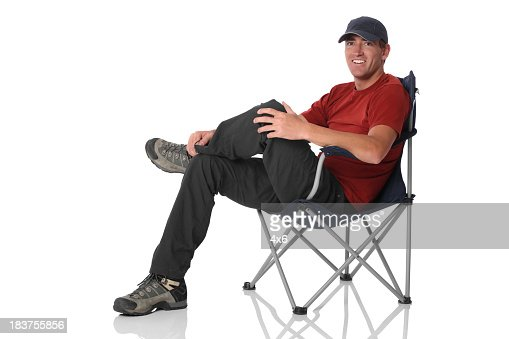 Isolated casual man sitting in camping chair