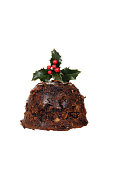 isolated christmas pudding with holly on white