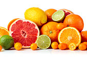 Isolated citrus fruits. Pieces of lemon, lime , tangerine , pink grapefruit and orange isolated on white background.