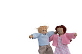 Isolated die cut of Cute couple wooden dolls walking together for Valentine's love or friendship concept in relaxation fun mood