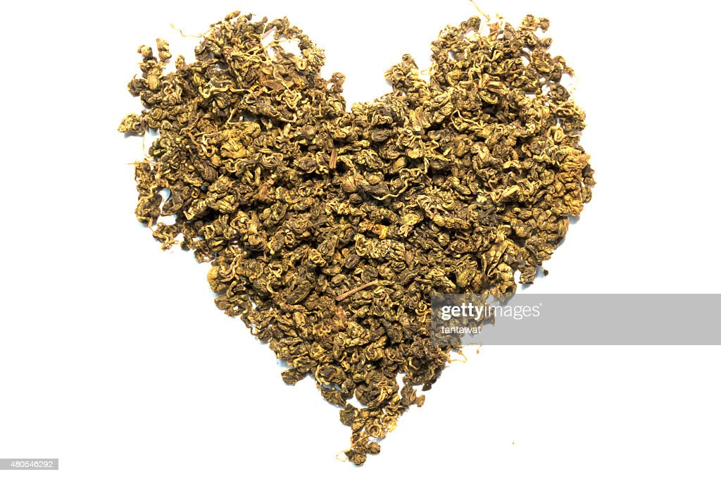 Isolated dry tea leaf heart shape : Stock Photo