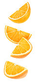 Isolated orange wedges. Four falling pieces of orange fruit isolated on white background with clipping path
