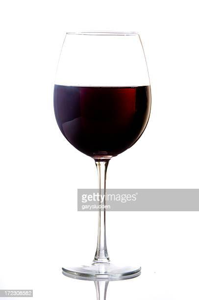 Isolated glass of dark red wine