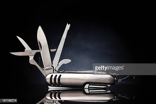 Isolated gray pocket knife with its tools extended