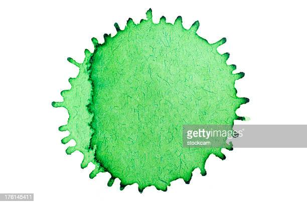 Isolated green ink splatter drop close-up