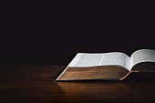 Isolated Holy Bible in a dark background.
