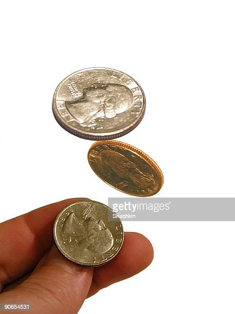 Isolated image of a coin being tossed in the air