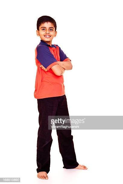 Isolated Indian Boy Standing Cheerful Full Length Arms Crossed