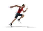 Isolated on white male athlete. The man is wearing an unbranded sports uniform and track shoes.