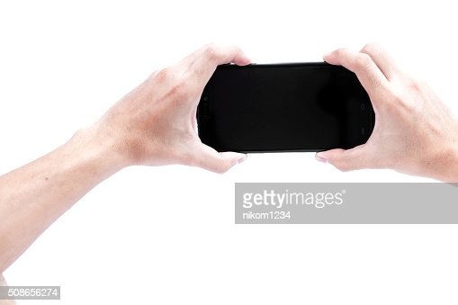 Isolated male hands holding the Smartphone : Stock Photo