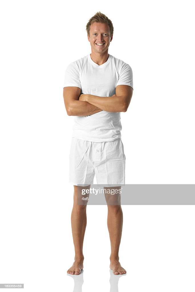 Isolated male standing in boxers and a tee shirt