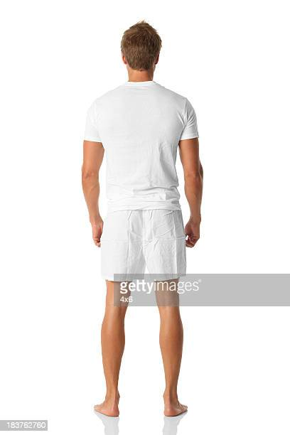Isolated man looking away standing in boxer shorts