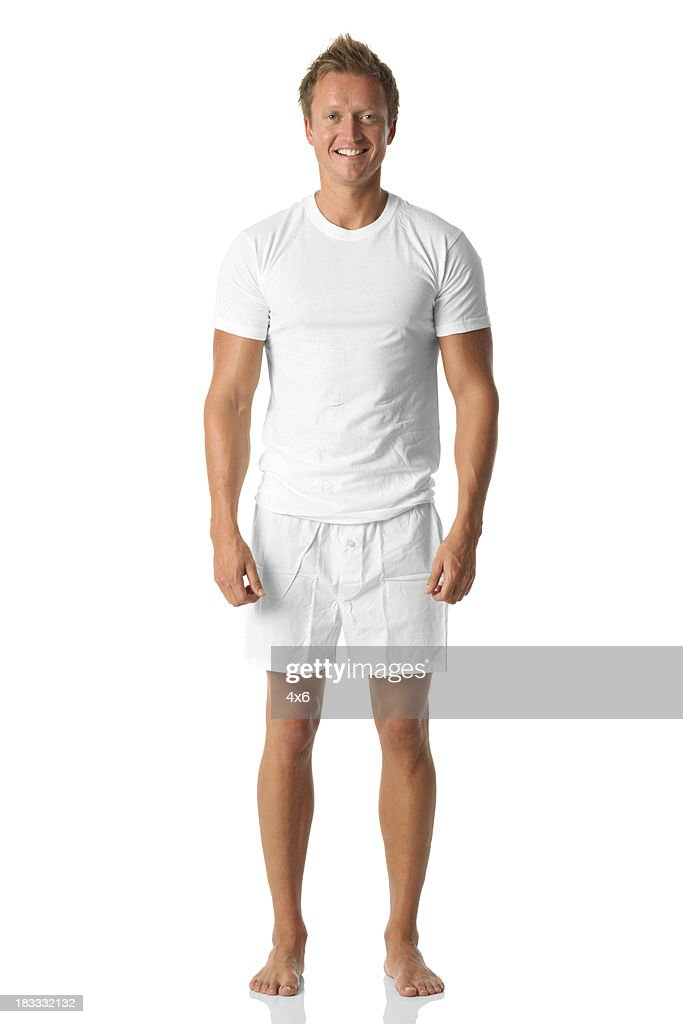 Isolated man standing in white shirt and boxers