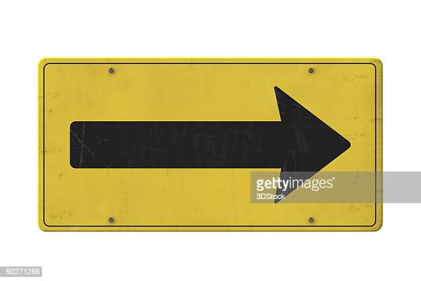 Isolated old yellow arrow sign