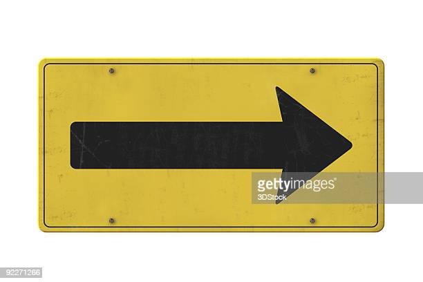 Viejo aislado amarillo señal de flecha