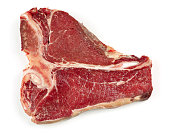 raw T bone steak isolated on white background, top view