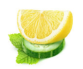 Isolated slices of cucumber and lemon and mint leaf (cocktails ingredients) isolated on white background with clipping path
