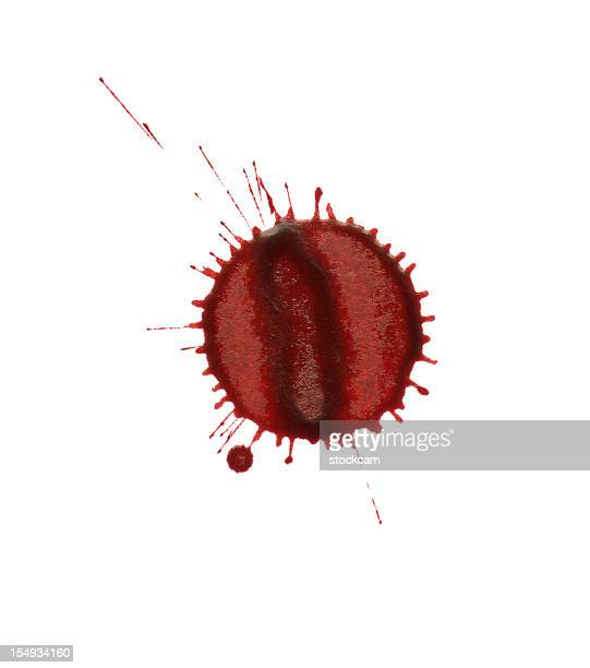 Isolated red blood splatter drop close-up