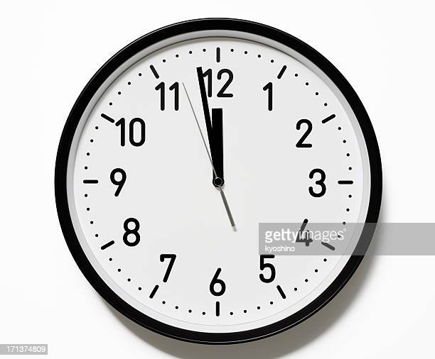 Isolated shot of 12 O'Clock clock face on white background