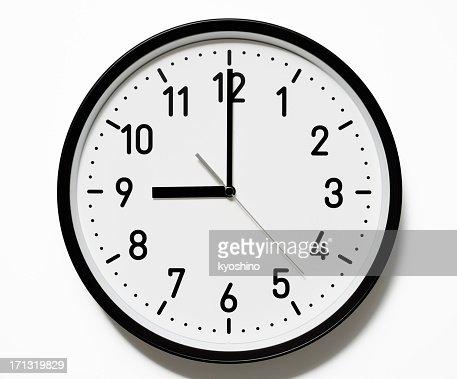Isolated shot of 9 O'Clock clock face on white background
