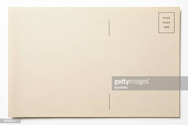 Isolated shot of antique postcard on white background