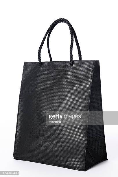 Isolated shot of blank black shopping bag on white background