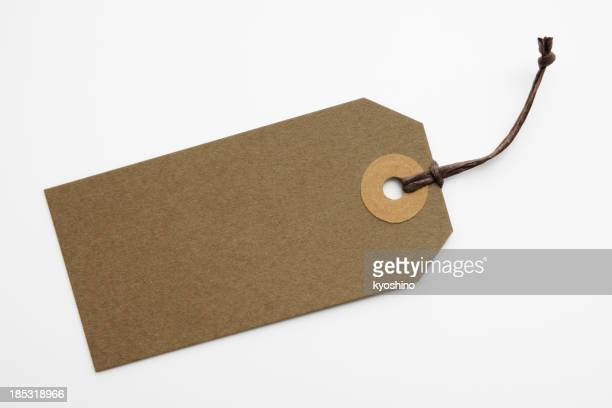 Isolated shot of blank brown paper tag on white background