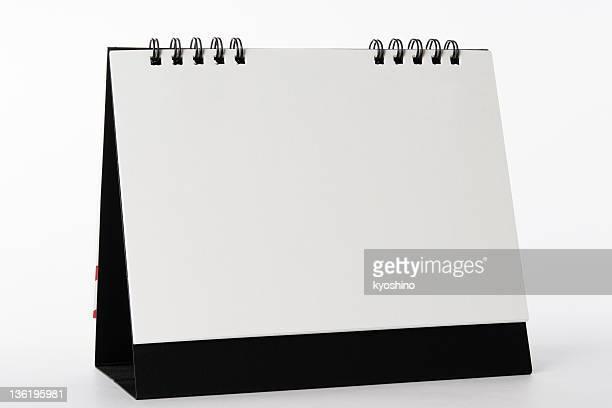 Isolierte Schuss von leere desktop-Kalender auf weißem Hintergrund