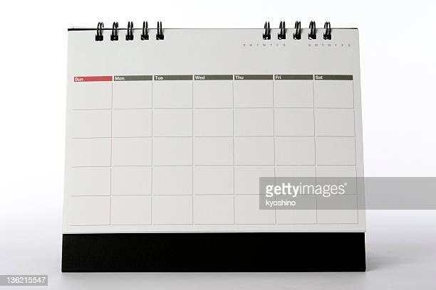 Fotografía de escritorio en blanco aislados de calendario sobre fondo blanco