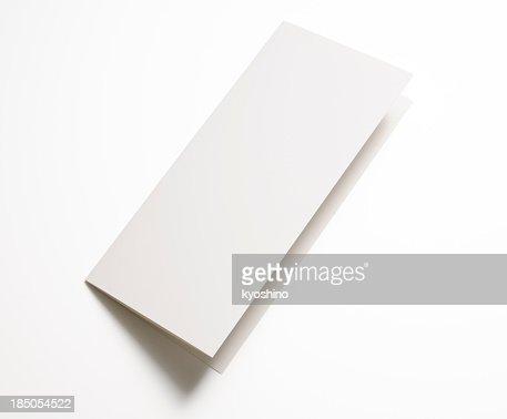 絶縁ショットのブランク白い背景紙に折り返し
