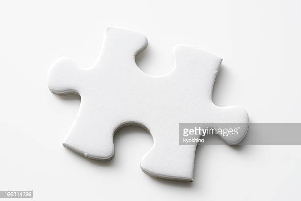 Isolated shot of blank jigsaw puzzles piece on white background