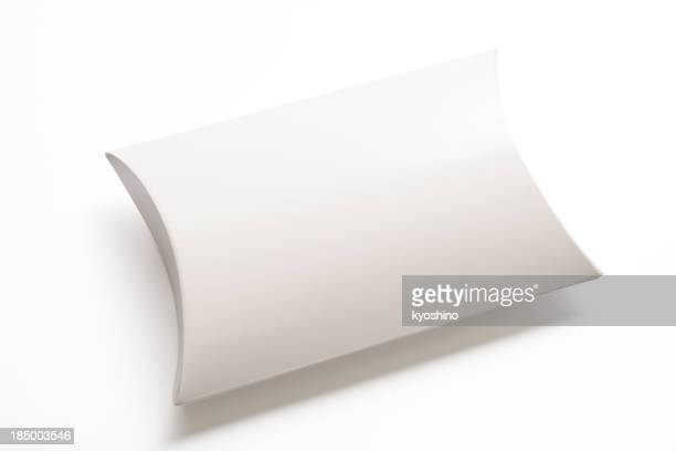 Isolated shot of blank pillow shape box on white background