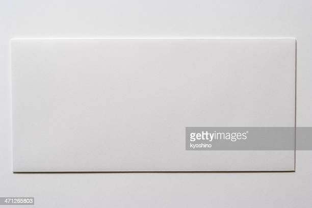 Isolated shot of blank white envelope on white background