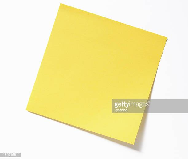 Isolated shot of blank yellow sticky note on white background