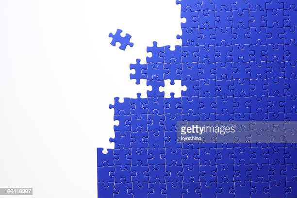 Isolated shot of blue jigsaw puzzle on white background