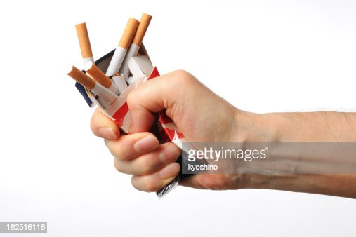 Isolated shot of broken cigarettes on white background