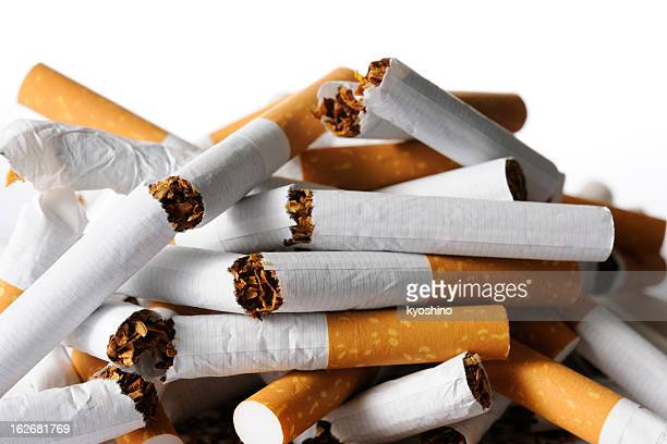 Isolated shot of broken new cigarettes on white background